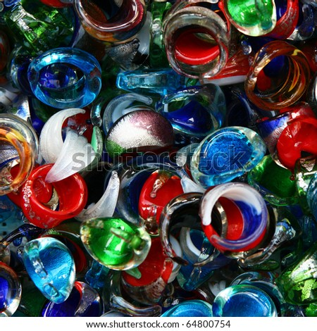 Glass  bright colorful rings,pendants and brooches on a street market table. Good for background. - stock photo