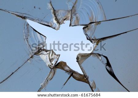 Glass  broken  hole; cracks - stock photo