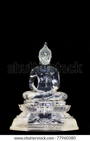 Glass Buddha, isolated against black background - stock photo