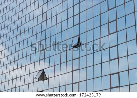 Glass building and shadow of cloud - stock photo