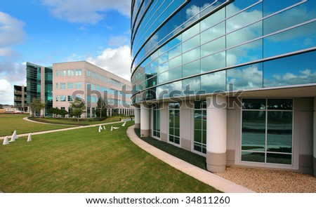 Glass Building with Blue Sky Reflecting - stock photo