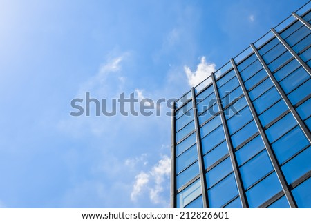 Glass building with reflection of the sky showing new perspectives and optimism - stock photo