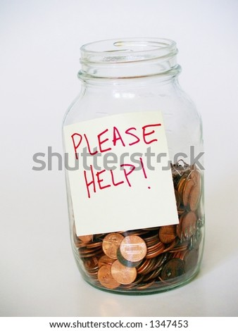 """Glass canning jar full of pennies, labeled with a sticky note reading """"PLEASE HELP!"""" - stock photo"""