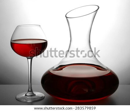 Glass carafe of wine on light background - stock photo