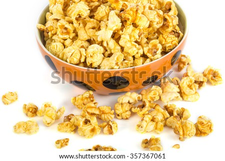 Glass ceramic bowl popcorn on white background