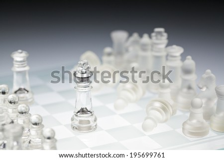 glass chess board,  the king - stock photo