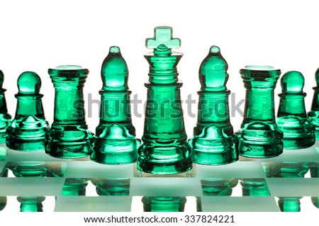 Glass chess. Green toned. It is isolated on a white background. - stock photo