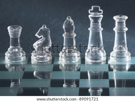 Glass chess is placed on a black background