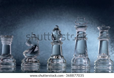 Glass chess is placed on black background - stock photo