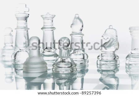 Glass chess is placed on white  background - stock photo