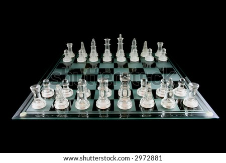 Glass Chess Pieces on a Frosted Glass Chess Board fully isolated on black