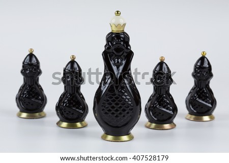 Glass chess pieces on a white background - stock photo