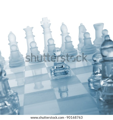 Glass chess. The first move. Blue toned. - stock photo