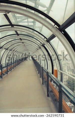 Glass conduit at Pompidou Centre in Paris France. Instagram style filtred image - stock photo
