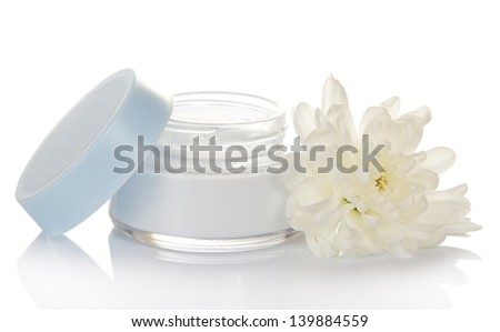Glass container of cream and fresh flower isolated on white