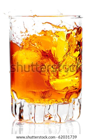 Glass containing rum, whiskey or any other golden liquor with ice on a white background - stock photo