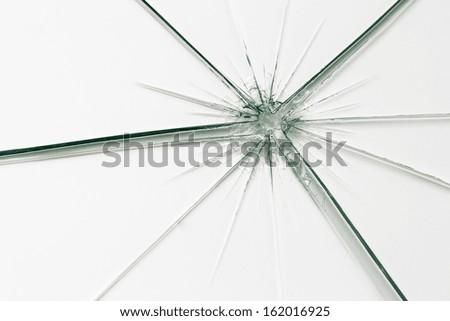 glass crack splitter Broken window on white gray background - stock photo