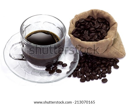 glass cup coffee with coffee beans around - stock photo