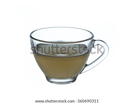 glass cup of green tea isolated on a white background