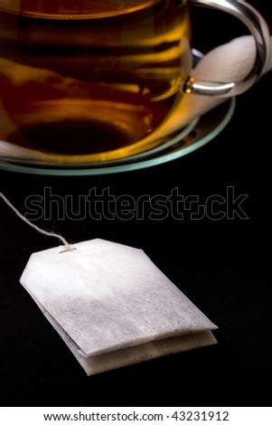 glass cup of tea in black background