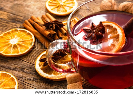 Glass cup of tea in it and anise orange and cinnamon. - stock photo