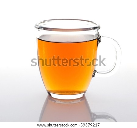 Glass cup of tea on a white background - stock photo