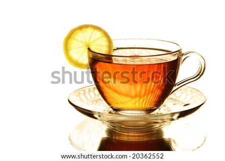 Glass cup of tea with lemon on a white background - stock photo