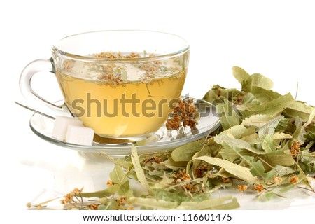 Glass cup of tea with linden isolated on white - stock photo