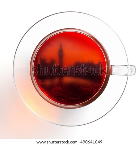 Glass cup of tea with the silhouette of London, isolated on the white background, clipping path included.