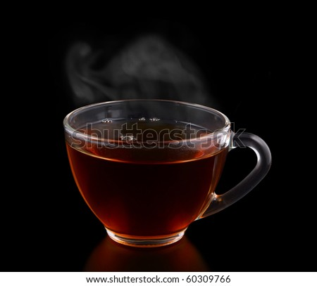Glass cup of tea with vapor isolated on black