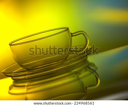Glass cup on colorful background - stock photo
