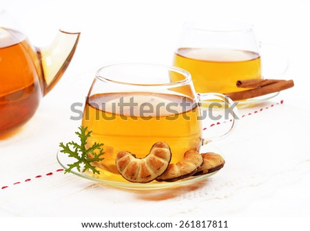 Glass Cup Tea with biscuits,cinnamon - stock photo