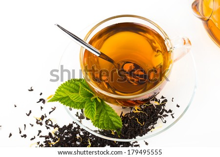 Glass Cup Tea with camomile flower and Mint Leaf, on white background - stock photo