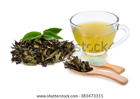 Glass Cup Tea with green leaves on white background