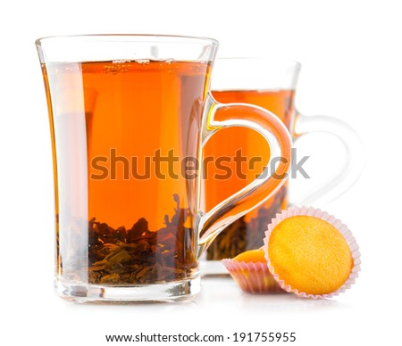 glass cup with black tea, cake muffin stuffing raisins, isolated on a white background