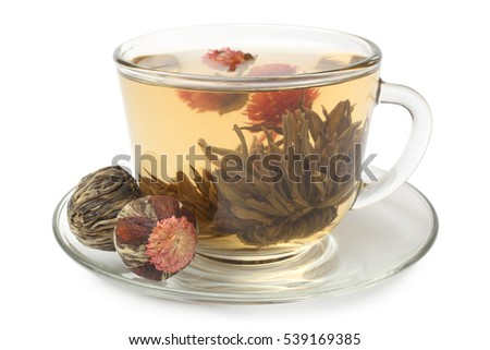 Glass cup with flowering tea on white background
