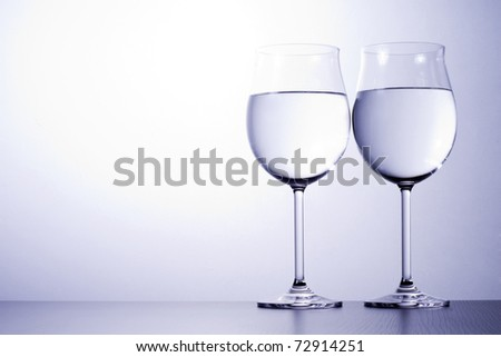 Glass cups, and lit up in style. - stock photo