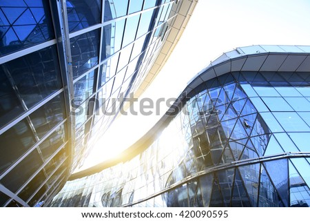 Glass curtain wall of modern office building - stock photo