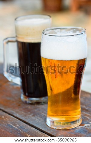 Glass dark and light of beer on wood table