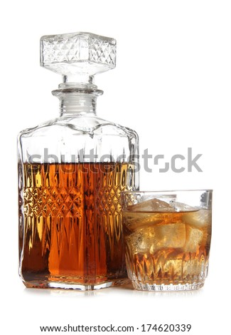 Glass decanter of whiskey on white background - stock photo