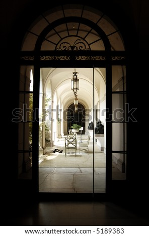Glass door leads to patio and garden - stock photo