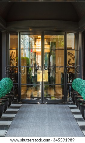 Glass door of modern on background. - stock photo