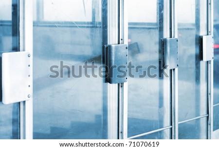 Glass doorsinto metro station - stock photo