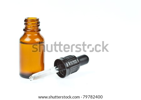 Glass dropper filled with moisturizing concentrate - stock photo