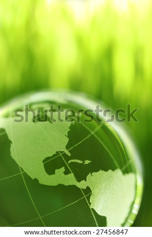 Glass earth in grass