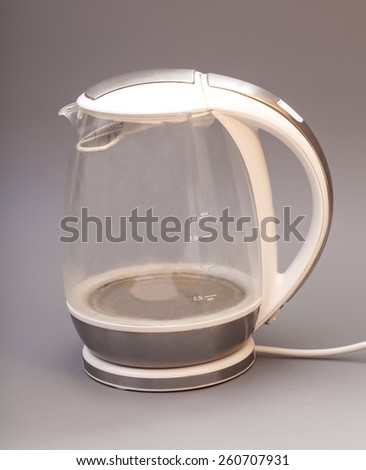 glass electric kettle isolated on gray background - stock photo
