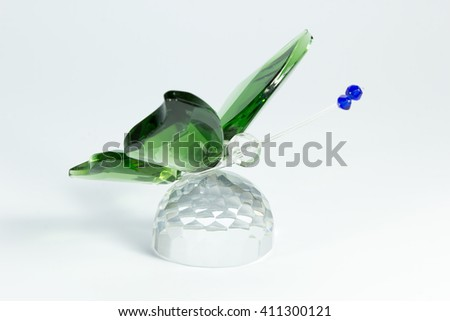 glass figurine of of a butterfly on a white background - stock photo