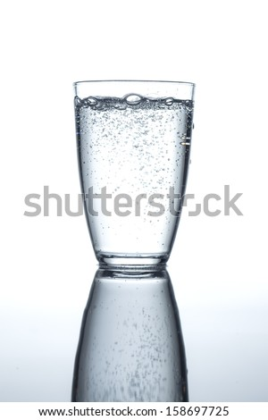 glass filled with sparkling water - stock photo