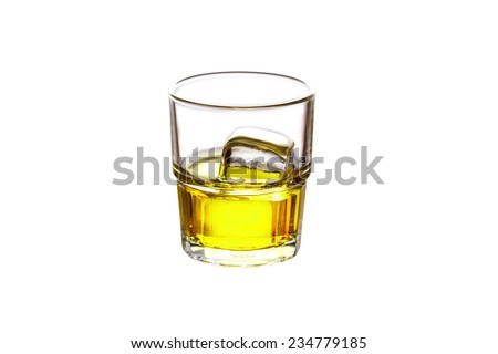 Glass filled with whiskey and ice isolated on white