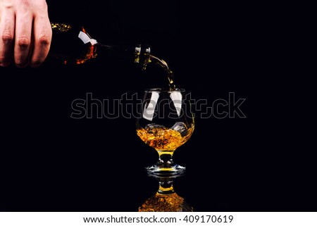 glass for cognac on black background - stock photo